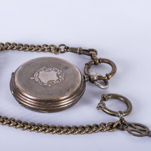 Antique pocketwatch with attached key